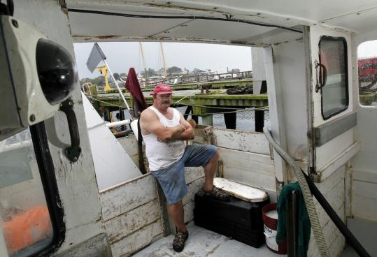 A camera, at left, on Gloucester fisherman Bill Skrobacz's boat, is designed to monitor the catch under federal regulations.