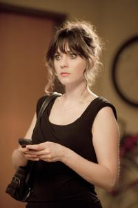 Zooey Deschanel stars as an offbeat woman looking for love and living with three single guys in ''New Girl.''