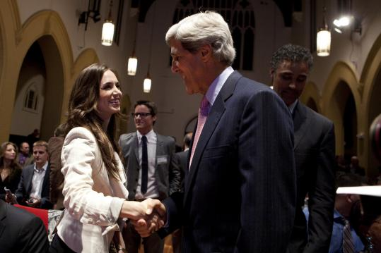 Eliza Dushku and Rick Fox (far right) with Senator John F. Kerry at the awards event.