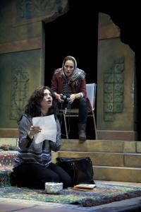 "Christina Pumariega (left) and Beth Wittig play an Iranian and an American, respectively, and their daughters, years later, in ""The Persian Quarter'' at Merrimack Repertory Theatre."