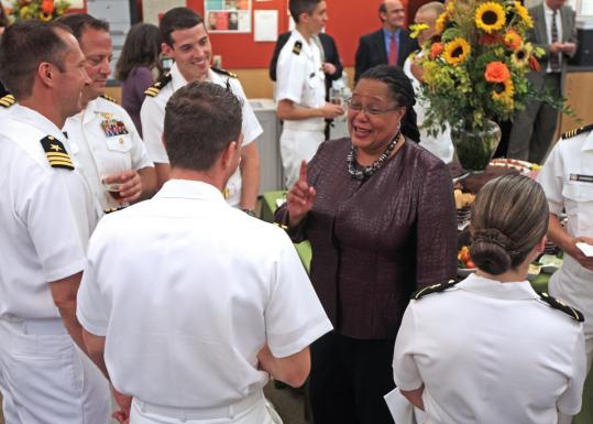 Evelyn M. Hammonds, dean of Harvard College, laughed with Navy ROTC members at a campus ceremony in Cambridge.