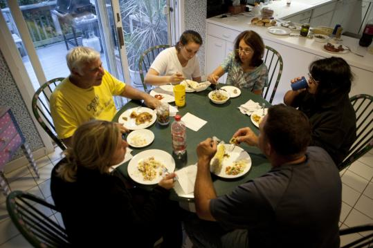 A family dinner for (from left) Merrill, Alexandra, and Sally Goldfarb of Needham can also include visiting friends.