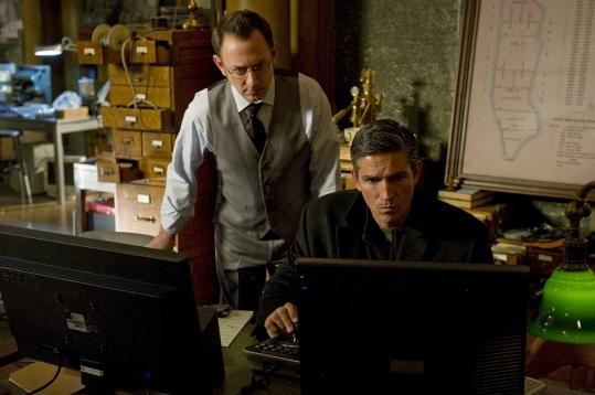 "Michael Emerson (left) and Jim Caviezel star in the CBS crime drama ""Person of Interest.''"