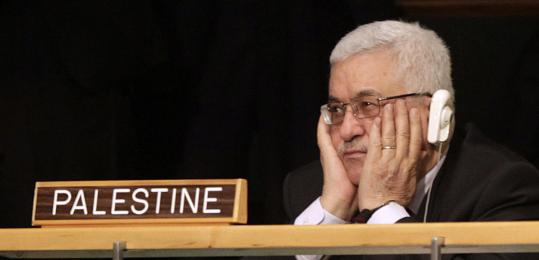 Palestinian President Mahmoud Abbas rubs his eyes while Barack Obama speaks at the United Nations headquarters Wednesday.
