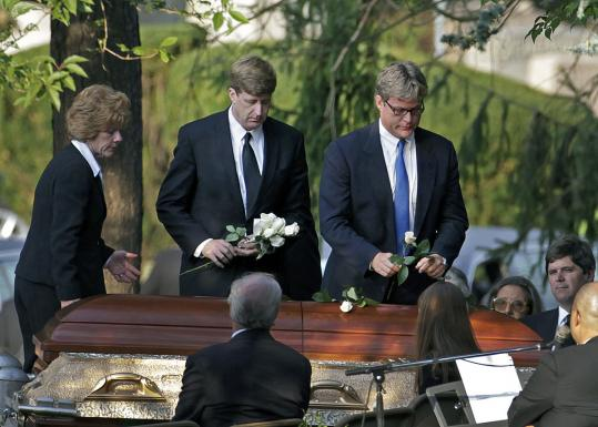 KARA KENNEDY LAID TO REST - Patrick Kennedy and Edward M. Kennedy Jr. laid flowers atop the casket of their sister, Kara Anna Kennedy, yesterday at Holyhood Cemetery in Brookline. Kennedy died last Friday in Washington, D.C. B3.