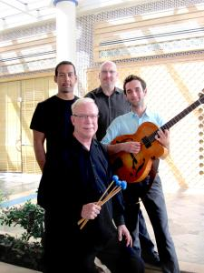 The New Gary Burton Quartet is (from left) drummer Antonio Sanchez, vibraphonist Burton, bass player Scott Colley, and guitarist Julian Lage.
