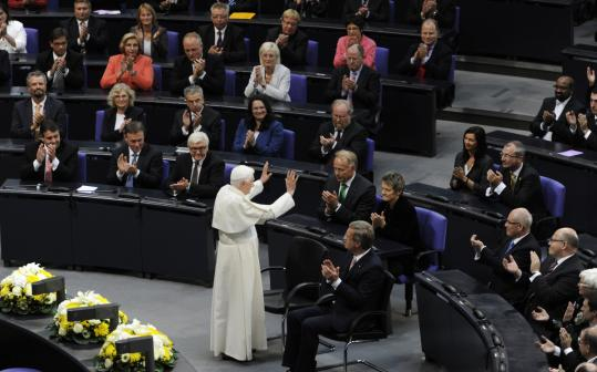 Pope Benedict XVI waved next to Germany's president, Christian Wulff, at the lower house of Parliament in the Reichstag.