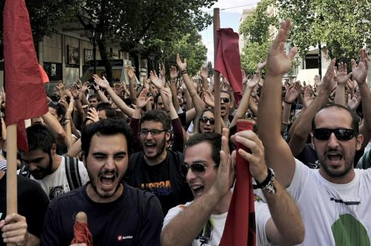 Students and teachers marched through Athens yesterday to protest cuts that Greece's government is making to meet the European Union's conditions for a new installment of aid.