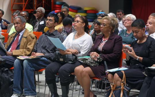 Attendees at a meeting at the Dudley Street Branch of the Boston Public Library last night heard several groups warn against opening a Wal-Mart store in Roxbury.