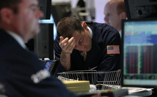 Traders worked on the New York Stock Exchange floor yesterday. The Dow had its worst two-day decline since 2008.