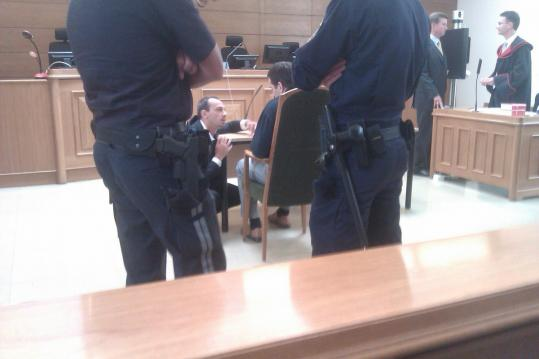 Dejan Karabasevic (seated), an engineer for an American Superconductor unit in Austria, apologized and got jail time.