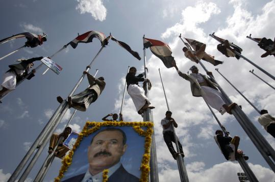 Supporters on flagpoles celebrated Ali Abdullah Saleh's return of to Yemen after nearly four months in Saudi Arabia.