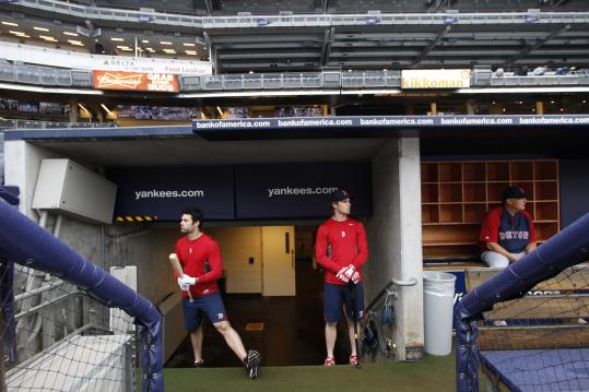 The weather in New York eliminated on-field warm-ups for Conor Jackson (left) and Josh Reddick, which was just as well since the Red Sox and Yankees were rained out in their series opener, leading to a day-night doubleheader tomorrow.