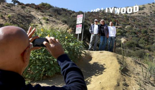 GPS has opened up the labyrinth of narrow roads in the Hollywood hills to tourists seeking photos of a showbiz icon.