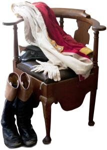 A Revolutionary War reenactor's uniform is draped across a chair in the Munroe Tavern (inset above), a Lexington Historical Society property being rededicated at 2 p.m. today.