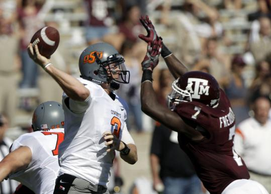 Oklahoma State quarterback Brandon Weeden passed for a school-record 438 yards and two touchdowns.