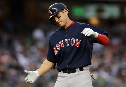 Jacoby Ellsbury shows his frustration after flying out in the seventh with the Sox down by nine.