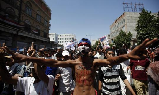 An antigovernment protester shouted slogans in the Yemeni capital of Sana during a demonstration yesterday.