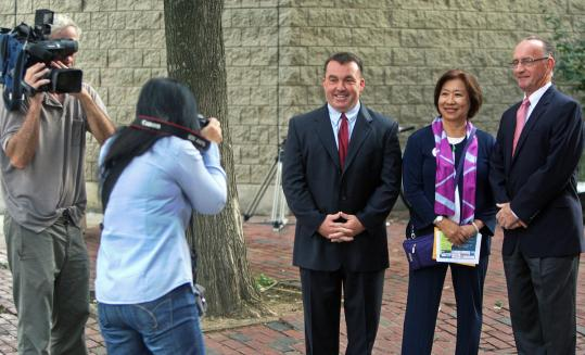 District 2 Boston City Council candidates (left to right) Robert Ferrara, Suzanne Lee, and Bill Linehan posed before a voters' forum last week at the Quincy School.