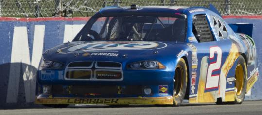 Brad Keselowski drives his No. 2 Dodge on the back straightaway en route to a second-place finish at the Sylvania 300 at New Hampshire Motor Speedway.
