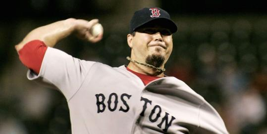 Josh Beckett lets loose with a pitch against the Orioles, but he couldn't secure a crucial victory.