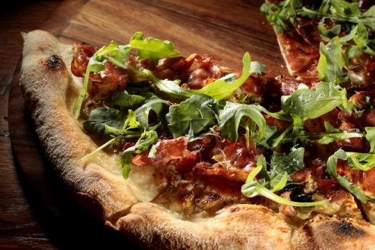 Salty Pig pizza is topped with a rotating selection of charcuterie.