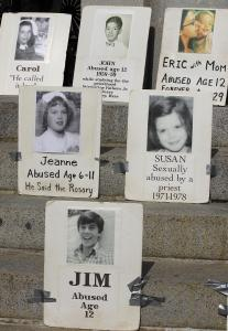 Photographs of victims could be seen on the State House steps yesterday during a rally and hearing on the statute of limitations in child abuse cases.