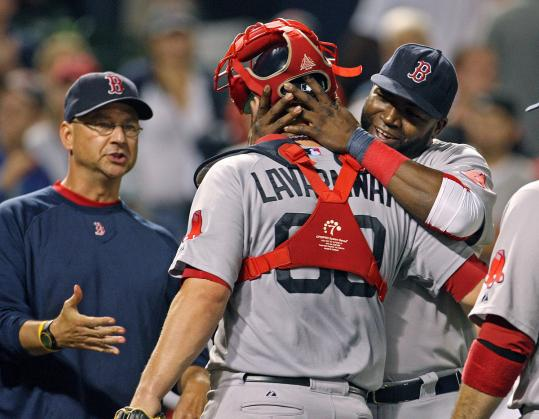 Manager Terry Francona celebrated last night's victory with Ryan Lavarnway and David Ortiz.