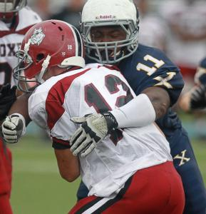 "Xaverian Brothers High lineman Maurice Hurst wraps up Brockton quarterback Paul Mroz last Saturday. ""Hitting and sacking the quarterback is my favorite part of the game,'' says Hurst, who is occasionally used on offense too."