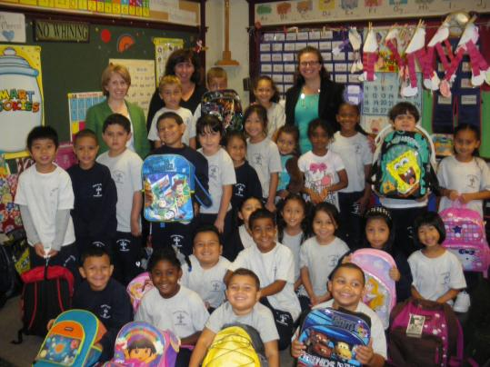 First-grade students at Saint Rose Grammar School in Chelsea received new backpacks and school supplies.