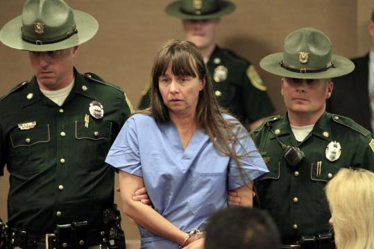 Julianne McCrery, 42, seen last May in a Portsmouth, N.H. court, would face 45 years to life for second-degree murder.