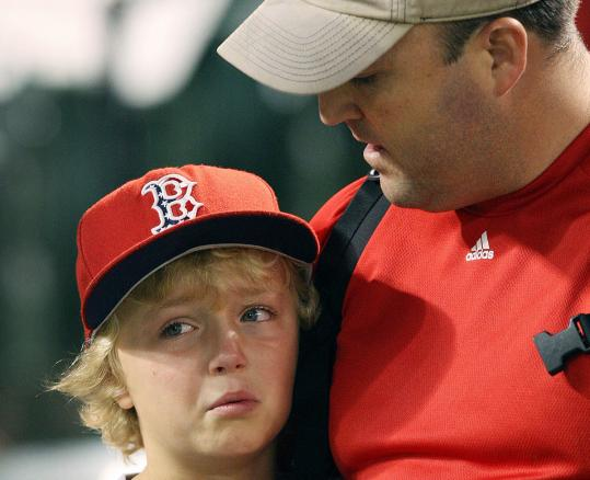 A young Sox fan in Baltimore needed consolation after learning that the Rays had beaten the Yankees.