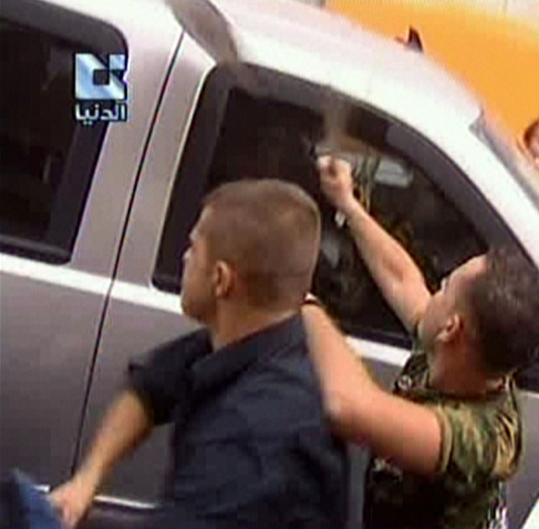 Supporters of President Bashar Assad attacked a US embassy vehicle yesterday.