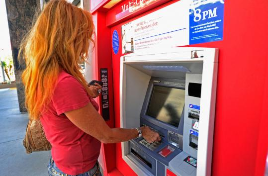 Bank of America plans to charge customers a monthly fee for using debit cards for purchases beginning in early 2012.
