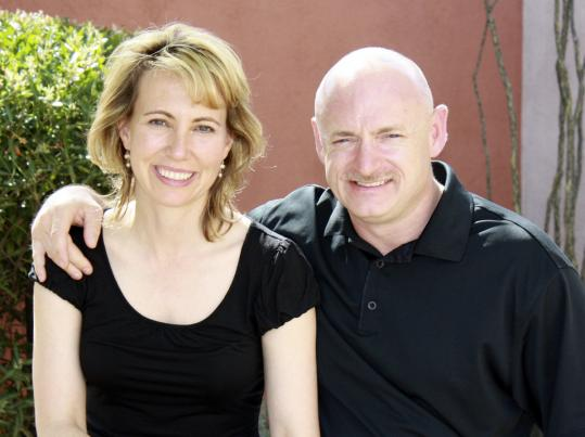 Representative Gabrielle Giffords in a file photo with her husband, Mark Kelly (above), and below on May 17.