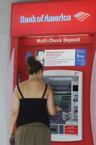 Some customers of Bank of America, the nation's largest bank, will face a $60 annual fee for using their debit cards next year.