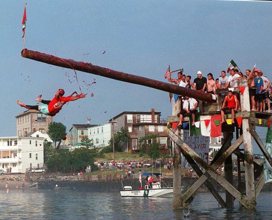 The grease splattered when a Greasy Pole contestant slipped into Gloucester Harbor at the annual Saint Peter's Fiesta off Pavilion Beach in 1994.