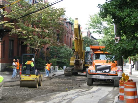 Crews work on Monmouth Street as part of a sewer project that has disrupted life for Brookline residents since the spring.