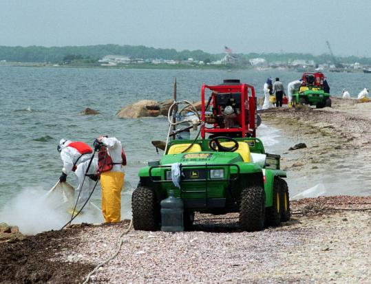 Workers were still cleaning up along the Fairhaven shoreline weeks (above) and months (left) after a Bouchard barge leaked 98,000 gallons of oil in Buzzards Bay in 2003.