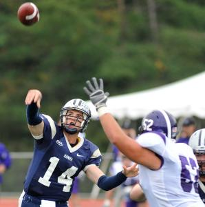 Kevin Decker throws one of his career-high four touchdown passes during the first quarter in New Hampshire&#8217;s last-minute victory over Holy Cross.