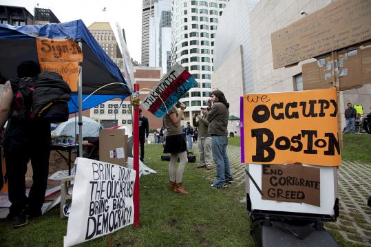 Tents mark the Occupy Boston protests in Dewey Square. Inspired by the Occupy Wall Street movement, demonstrations spread to other cities.