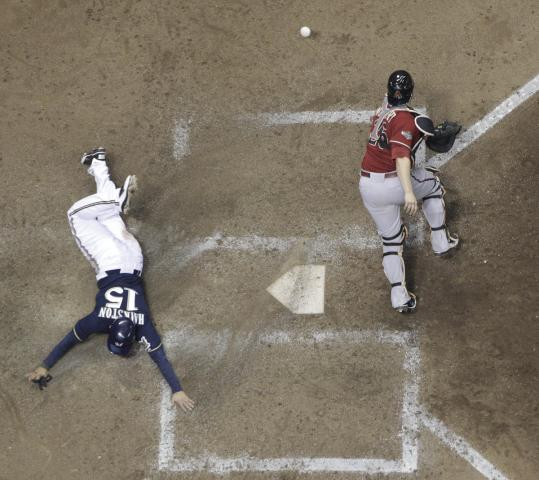 . . . scored Jerry Hairston Jr., and gave the Brewers a 5-4 lead. The throw got away from catcher Miguel Montero.