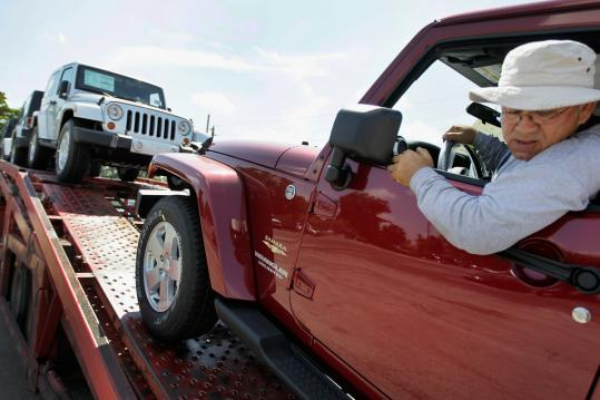 Jose Ortega delivered vehicles to a Chrysler Jeep sales lot in Hollywood, Fla. Truck sales at Chrysler grew in the double digits.