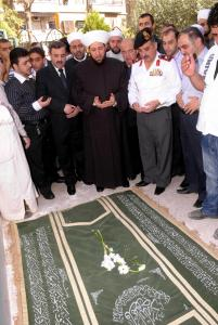 This official handout photo shows Grand Mufti Ahmad Badreddine Hassoun (center) praying over his slain son's coffin on Sunday.