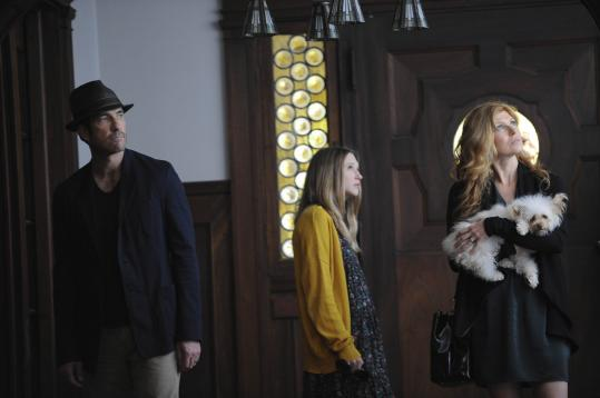From left: Dylan McDermott, Taissa Farmiga, and Connie Britton move from Boston to a 1920s-era house in Los Angeles in which a murder-suicide took place.