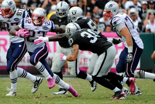 Running back Stevan Ridley (22) had holes to run through thanks to the blocking of tight end Rob Gronkowski (87).