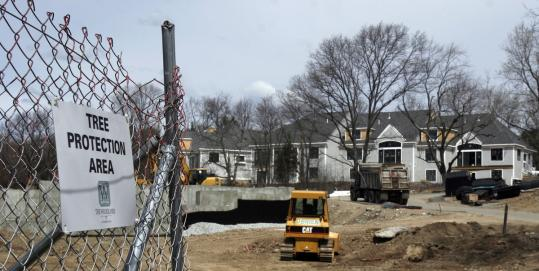 Some condominiums have been built near McLean Hospital, but further development became bogged down in legal battles. A local committee is now pushing for construction of 320 luxury apartments and condos in the area.