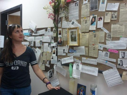 "At Lynn's Northeast Behavioral Health, Mary Wheeler views ""The Remembrance Wall'' of those who have died from drug use. She directs two Healthy Streets Outreach Programs in the area."
