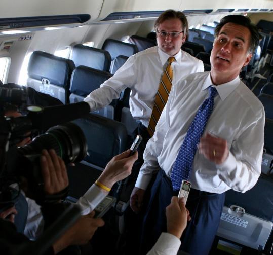 Eric Fehrnstrom (at rear) has often been fierce in his defense of Mitt Romney.
