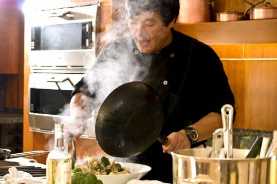 Ming Tsai mixes things up (perhaps with a pinch of native rum?) at a Barbados Food & Wine and Rum Festival demo.